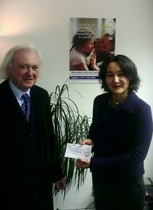 Image of Sophie, Kindred CEO accepting cheque from Jim McGuire
